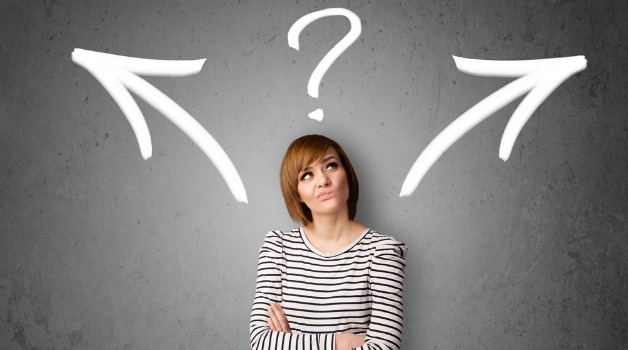 woman looking up confusingly with a question mark on top of her head