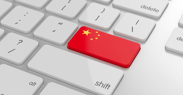 Flag of China on a computer keyboard, depicting online buying