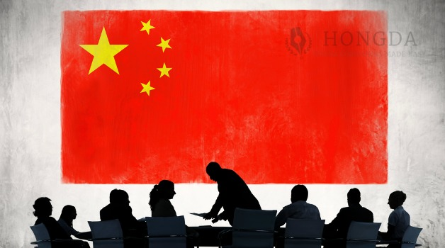 picture of china flag with shadows of people working