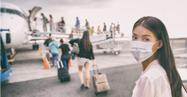 Woman in a mask boarding a plane to China